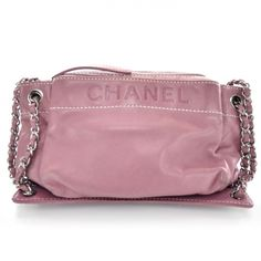 This is an authentic CHANEL Lambskin Lax Accordion Hobo in Pink.   This stylish shoulder bag is crafted of luxurious lambskin leather with a large Chanel name logo embossed frontally.