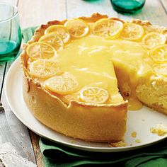 Lemon Bar Cheesecake - To-Die-For Cheesecake Recipes - Southernliving. This indulgent recipe marries two delicious desserts: lemon bars and cheesecake. Using a dark springform pan ensures a golden brown crust on this tart dessert recipe without having to Lemon Desserts, Lemon Recipes, Just Desserts, Sweet Recipes, Delicious Desserts, Cake Recipes, Dessert Recipes, Yummy Food, Impressive Desserts