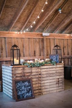 Drape garlands of greenery around a pallet bar + set candles on top for a romantic touch.