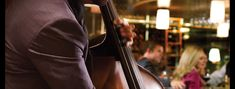 A stand up base player plays live jazz music at Eddie V's