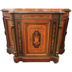 Beautiful century American rosewood credenza with spectacular marquetry. The door opens to reveal an amazing all birds, eye maple interior. Features bronze mounts on the columns, top… Antique Furniture, Modern Furniture, Renaissance, Hickory Chair, Modern Cabinets, Marquetry, Dark Wood, American, Credenza