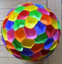 Paper ornament made from different coloured mini cupcake cases - I love this