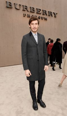 Swedish model Robert Konjic wearing Burberry outerwear as he attends the Prorsum Menswear A/W14 show in London