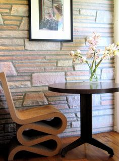 #folded chair #stone wall in the hallway