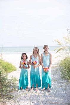 Beach Wedding Flower Girls | Laura Elizabeth Photography | Read More: http://stylemepretty.com/2013/08/29/sanibel-island-florida-wedding-from-laura-elizabeth-photography/