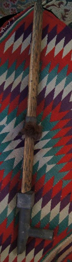 Early Chippewa stone pipe carved in the Central Plains tradition & yet using local fine grained sandstone. Complete with the original stem of carved oak hollowed & intentionally hammered in a tiger pattern. Bound with sinew which affixes some fine animal fur (possibly ermine or mink). The piece is perfectly intact. The original stem fits beautifully into the pipe and the lovely patina on the stem & the carved bowl show years of care & use. Circa 1880.