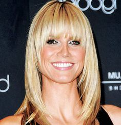 Heidi Klum with curved bangs- Read all about the different types of bangs!