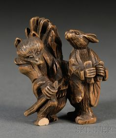 Boxwood Netsuke, Japan, 19th century, carving of a fox and a rabbit, dressed in human attire and carrying firewood, lg. 1 3/4 in.