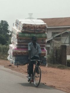 Ugandans can carry just about anything on a bike!