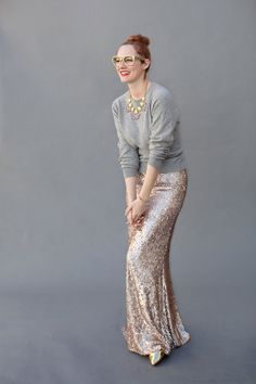 how to wear sequins for the holidays: A sequin maxi skirt is veryyyyy glamorous. Add a plain sweater to tone it down a little.