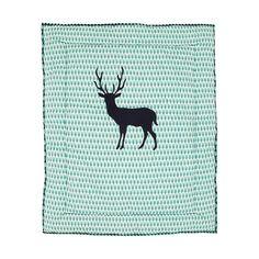 Comfortabele kleed voor in de box, maar kan ook op de vloer gebruikt worden. Met een vilten applicatie van een hert op een boomrijke achtergrond.