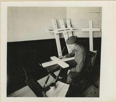   Base Hospital number 17, Dijon, France. Private 1st Class Lester Fenis painting names on crosses. Sept. 5, 1918