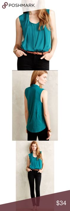 """Deletta Sz XS Anthro Green Rivulet Draped Blouse Deletta Sz XS Anthro Green Rivulet Draped BlouseSize XSGreen/teal colorCottonMachine WashRegular: 26""""LengthBust 32-34""""-does have stretch and will fit a size SmallDrape frontSilky front with cotton backRound hemSleevelessPre owned great condition. Anthropologie Tops Blouses"""