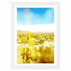 """Add a pop of contemporary style to your living room or home office with this eye-catching framed print, showcasing a neon landscape of a California desert.   Product: Framed printConstruction Material: Matte-proofing paperColor: White frameFeatures:  Limited open edition with certificate of authenticity by the artist Made in the USAArrives ready to hang with all hardware included  1.2"""" Frame Hand-framed   Cleaning and Care: Dust lightly using a soft, clean, lint-free cotton cloth"""