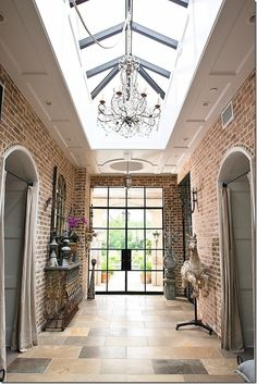 Kinda love this atrium for a second story hallway that may not have any other windows