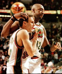 7b1ff7ba49c Seattle Supersonics John Crotty and Vin Baker celebrate their team's 8786  victory over the league leading