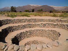 Descending spiral stone labyrinth;  stone; path; walk; spiral; labyrinth; pattern