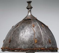 Tibet, eight plate helmet, 16th–17th century, iron and leather, H. 8¼ in. x Diam. 9 in. (21 cm x 22.9 cm); weight 36.7 oz. (1040 g), Met Museum.