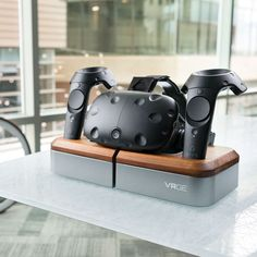 a0c4a32eeca A high quality VR docking station for storing and charging your HTC Vive.