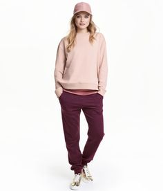 Check this out! Soft sweatpants with an elasticized drawstring waistband, side pockets, and ribbed hems. Brushed inside. - Visit hm.com to see more.