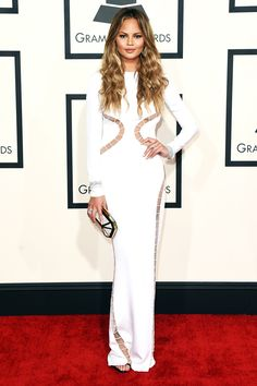 As a model (specializing in swimsuits, no less), Chrissy Teigen clearly knows how to dress for her shape. But, her white, hourglass cutout dress was especially pitch-perfect.