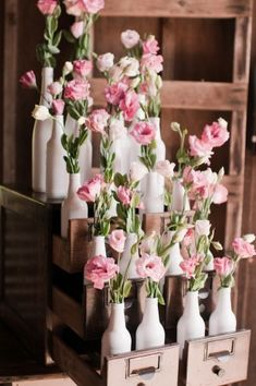 white bottle vases filled with pink flowers in an antique library card cabinet | http://withlov3.com/