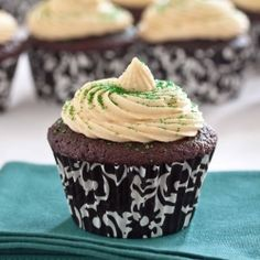 Celebrate St. Patrick's Day with Chocolate Stout Cupcakes with a Whiskey Ganache Filling and topped with Bailey's Irish Cream Frosting