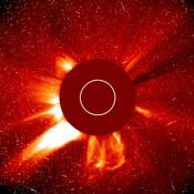 In photo from the Solar and Heliospheric Observatory, a major solar eruption is shown in progress Oct. 29, 2003. A large coronal mass ejection is being hurled toward the Earth. Through the process of sonification, this composer turns it into a symphony.