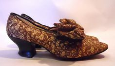 Creme dancing shoes with cocoa brown lace overlay and exagerrated sumptuous bows from the turn of the century. Louise XIV heels.