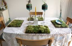 Moss placemats by MissMossy  Place mats are made with a variety of preserved mosses, to give it different shades and textures, on a bamboo base and now with lichens, twigs and pine cones.  These placemats are recommended for decorative or very light use only. They require no care but must be kept out of direct sunlight to preserve color. They may be stored in a dry closet with tissue paper layered between them when not in use.