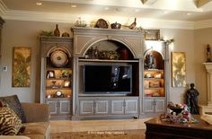 Furniture Style Entertainment Center houses a large TV and coordinates with the adjacent Kitchen Cabinetry Becky Pruett - freetime. Decor, Furniture, House, Home, Built Ins, Cabinetry, New Homes, Entertainment Center Furniture, Custom Cabinetry