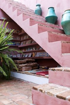ooh tiles under the pretty pink stairs