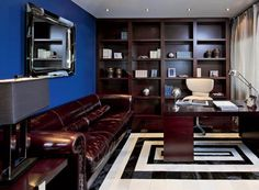 modern home office | Rich room colors and contrasting floor decor, blue wall with large ...
