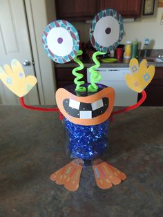 DIY monster party centerpiece, scrapbook paper, pipe cleaners and jars