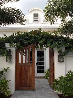 Love this bougainvillea-covered arched entry gate.