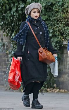 Cutting a lonely figure: The critically acclaimed actress in bulky attire on Friday in London when she was Christmas shopping