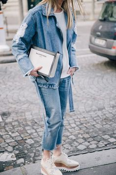 Denim cropped trousers and belted denim jacket with metallic flatform shoes. Street style.