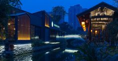 Chengdu Tianfu Riverfront Starbucks in China is composed by two free standing buildings which have a scenic river view. Architectural elements such as sliding windows and doors, ceiling fans are designed to making visual connections between two spaces to encourage a genuine moment of connection.