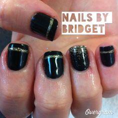 Fancy gold nail art on black nails