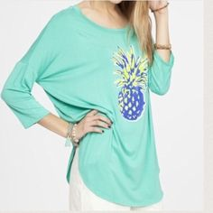 COMFY PINEAPPLE TOP Loving this top in this jade color!  The pineapple really pops in bright yellow and blue!  Super adorable and comfy!  Wear it with jeans or leggings or shorts! Comes in L. Please do not buy this listing. If you would like to bundle let me know what items and size and I will make a listing just for you instead of using the new bundle feature - new feature buys the entire listing. Oops!  NO PAYPAL NO TRADES Price firm unless bundled. Tops