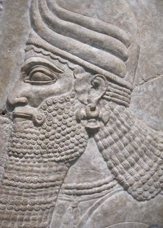 Head of a Winged Protective Spirit from Room B at the Northwest Palace of Nimrud, the Assyrian Capital. The alabaster wall relief dates back to the era of Ashurnasirpal II (883-859 BCE). Harvard Art Museums, Cambridge, MA.