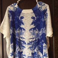 Knit White and Blue Floral Short Sleeve Top Adorable knit polyester short sleeve white top with blue tropical floral design. Semi-sheer. Comes from smoke-free home with a cat. bobeau Tops Tees - Short Sleeve