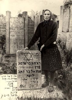 Cyrel Libek near a memorial stone for her husband (Duga) and others who perished.