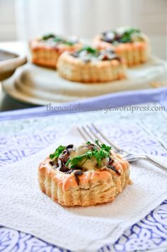 Tarlets with caramelized onions, mushrooms, and gruyere