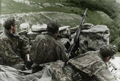 The bitter fighting against partisans went on throughout Yugoslavia. Here an MG30(t) team from the 7th SS Freiwilligen Gebirgs Division Prinz Eugen guards a mountain road in 1943. These soldiers, who were ethnic Germans from the Balkans, wear camouflaged field caps and smocks over their overcoats.