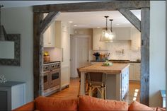 rustic beams in kitchen/living room. Looks sweet imo