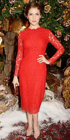 ANNA KENDRICK The actress gives us major holiday party inspiration in a red lace Dolce & Gabbana sheath with classic nude pumps at Claridge's Dolce & Gabbana Christmas Tree Party in London.