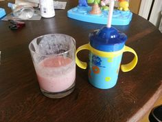 Fruit smoothies for my 10 month olds! Great alternative to the pureed food pouches. Buy a couple of sippy cups with flexible straws. Puree up some fruit, yogurt and baby oatmeal and you have a great snack for your little one!