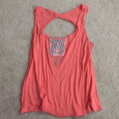 AEO tank with beading Beautiful bright coral tank top from AEO. Flowy fit with cute beading detail at the top. Looks great with white denim or olive green chinos! American Eagle Outfitters Tops Tank Tops
