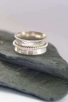 Dimpled Wide Spinner Ring Spinner rings are traditionally used to relieve stress through the repetitive process of spinning the inner band. They